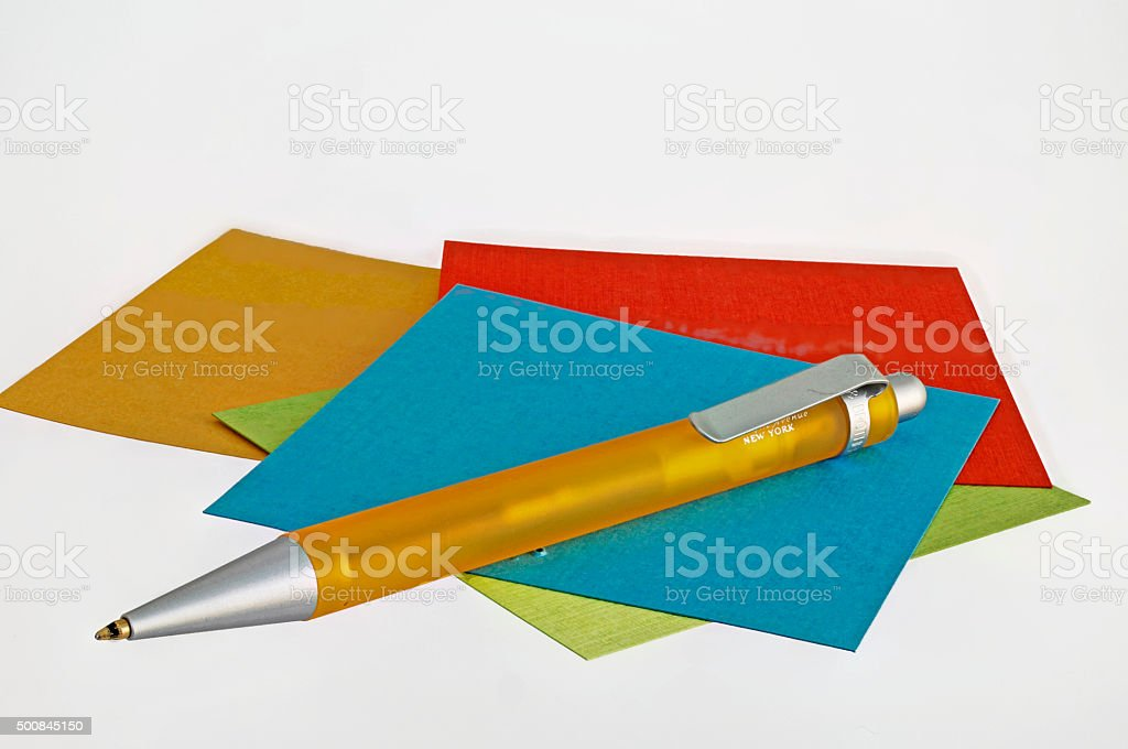 Note sheets in different colors and pen stock photo