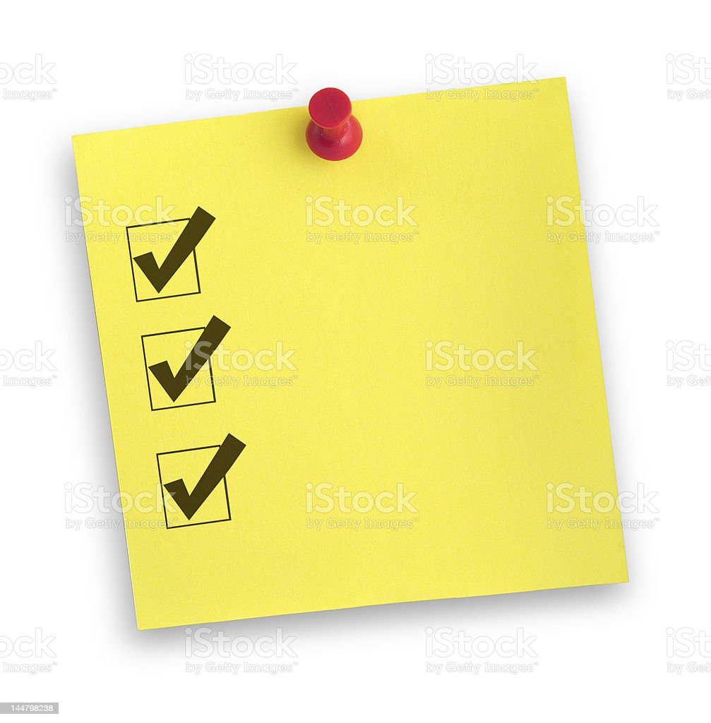 note with completed checklist stock photo
