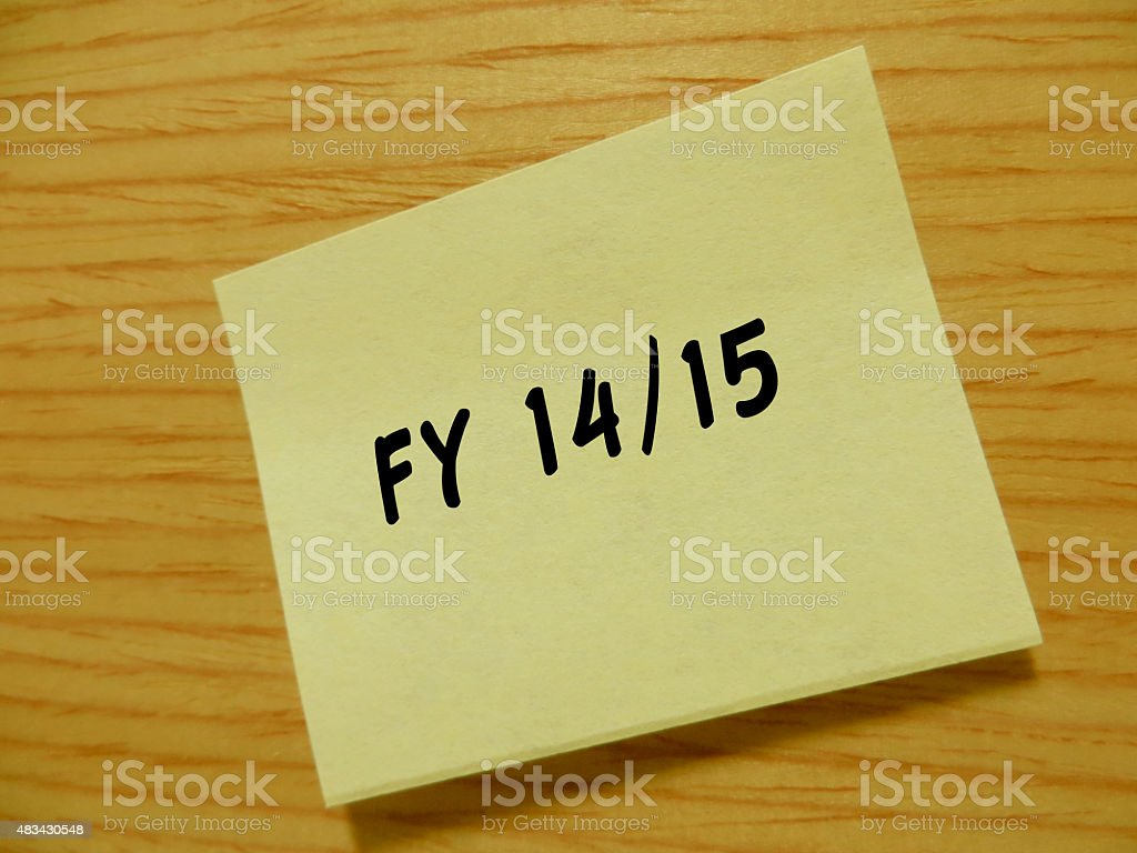 Note with 'Financial Year 14/15' stock photo