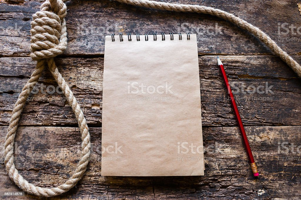 notebook and a loop for suicide stock photo
