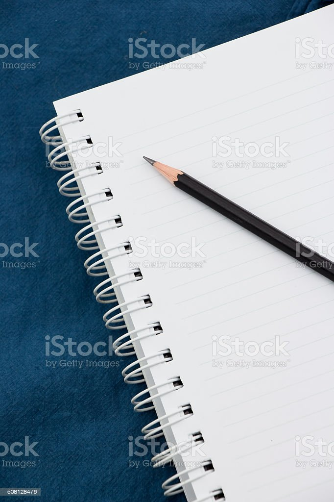 Notebook and black pencil stock photo