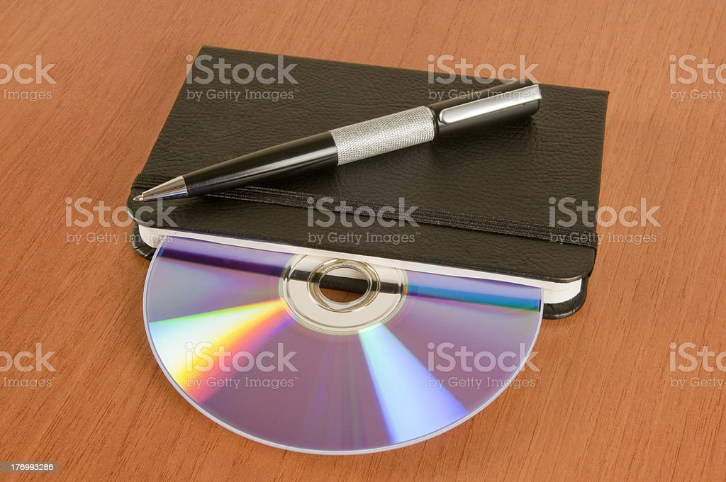 Notebook and cd royalty-free stock photo