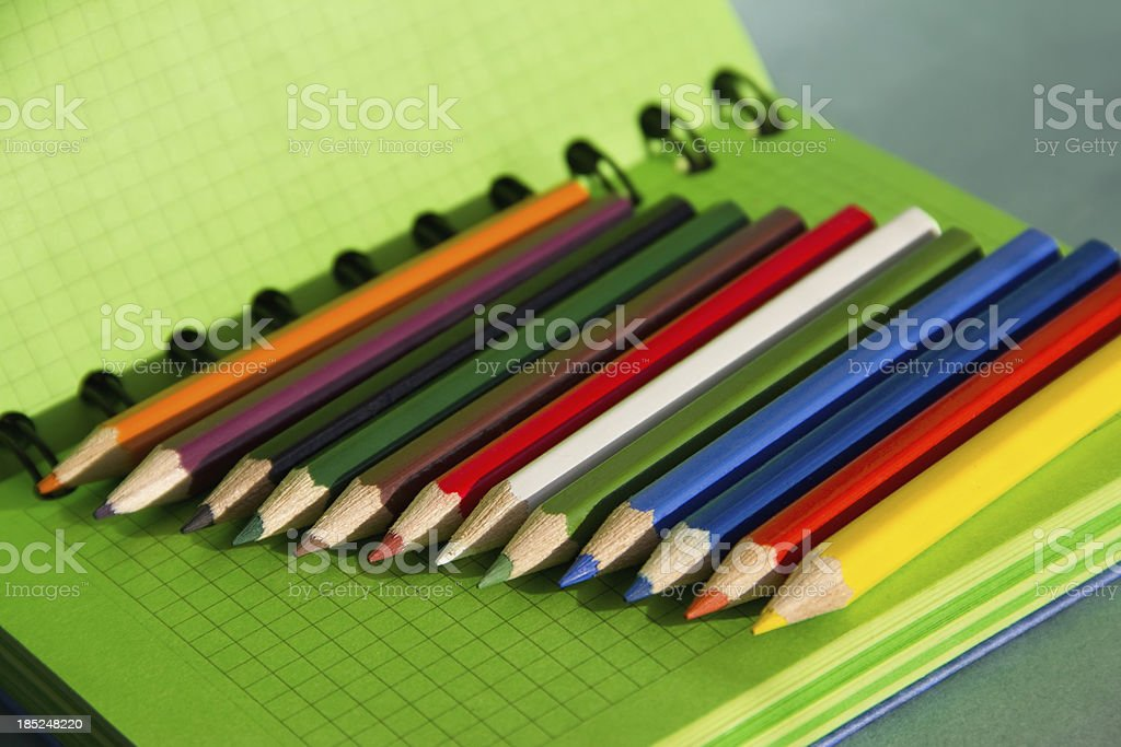 notebook and colored pencils royalty-free stock photo