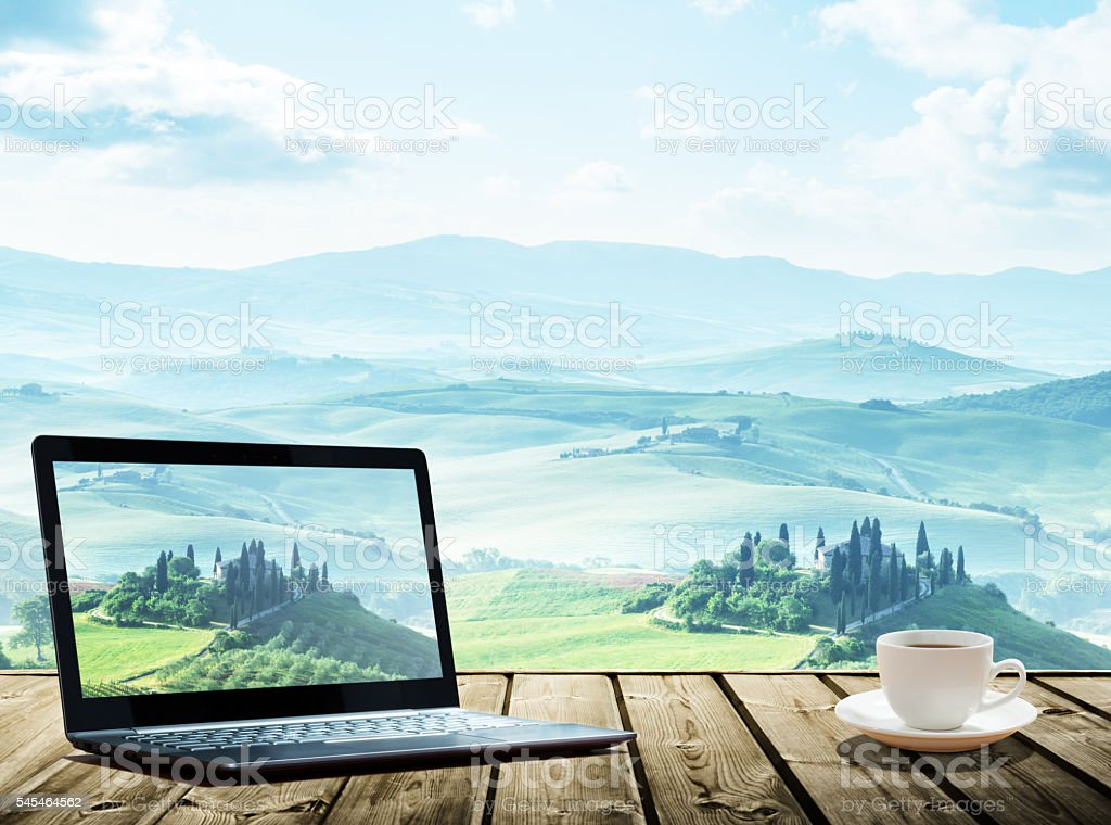 notebook and cup of cofee on table stock photo