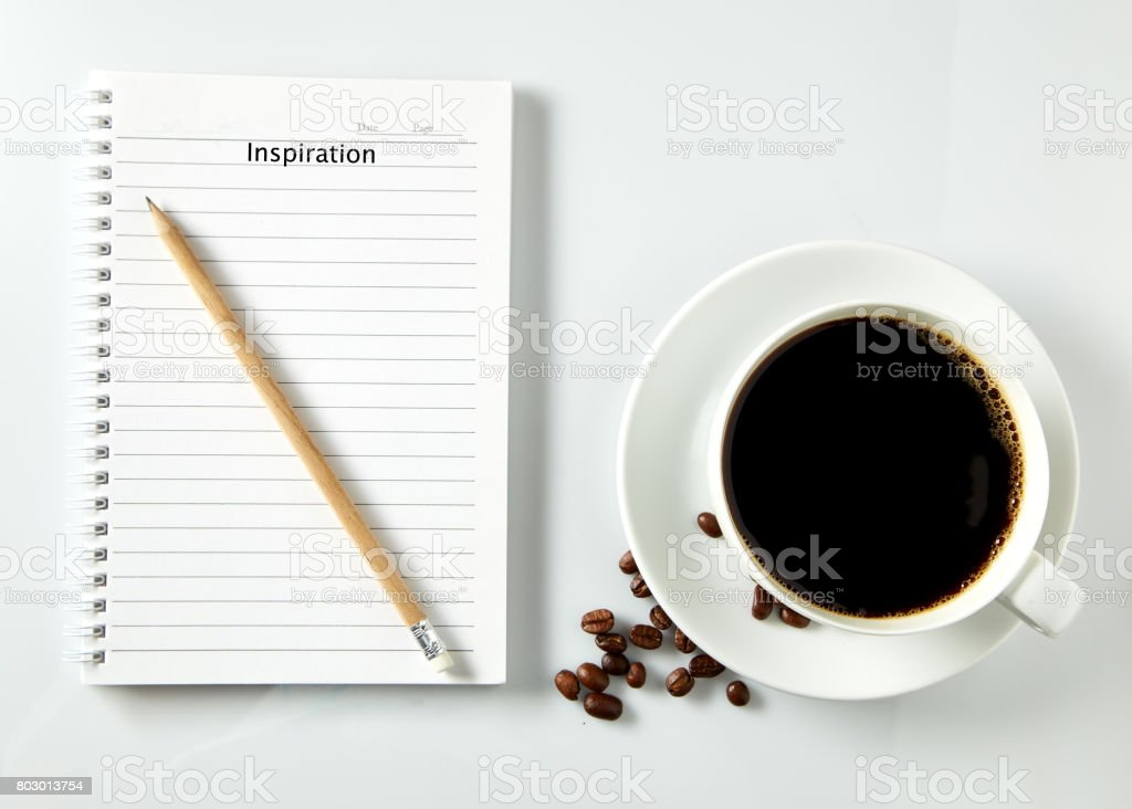 notebook and cup of coffee on white background stock photo