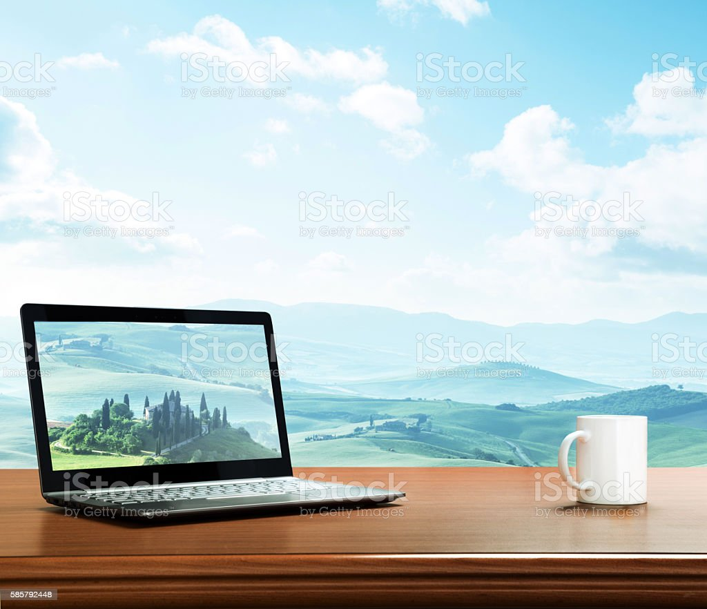 notebook and cup on table, tuscany, Italy as background stock photo