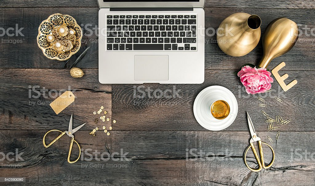 Notebook and golden office supplies. Flat lay office desk stock photo