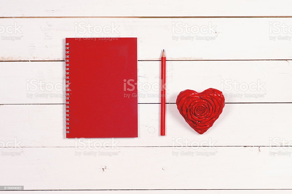 Notebook and heart on a white rustic background. stock photo