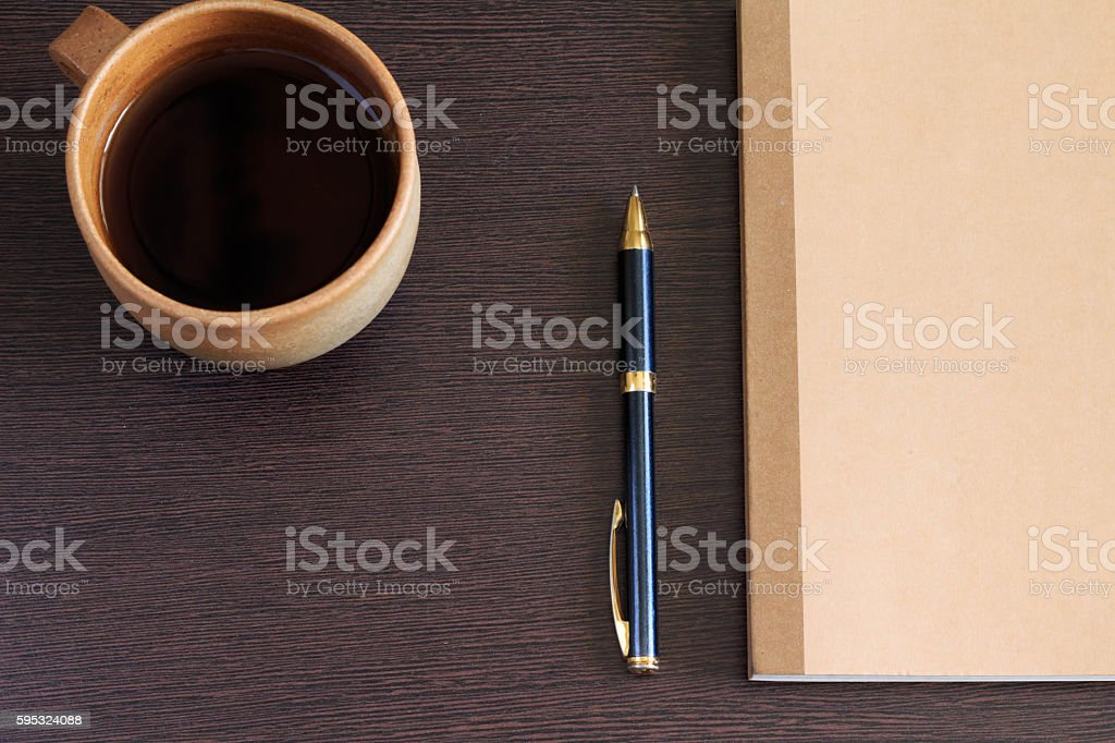 Notebook and pen and coffee stock photo