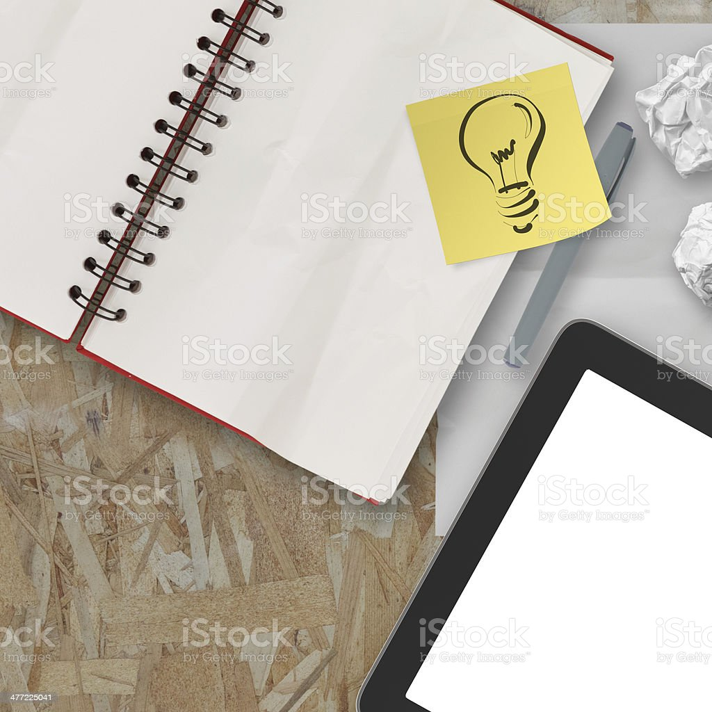 Notebook and pen and tablet on recycle wood table background royalty-free stock photo