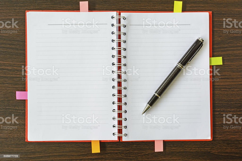 notebook and pen on wooden table royalty-free stock photo