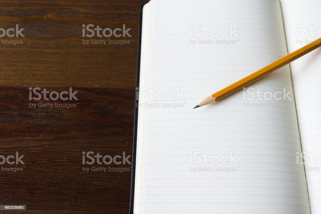 Notebook and pencil close-up stock photo