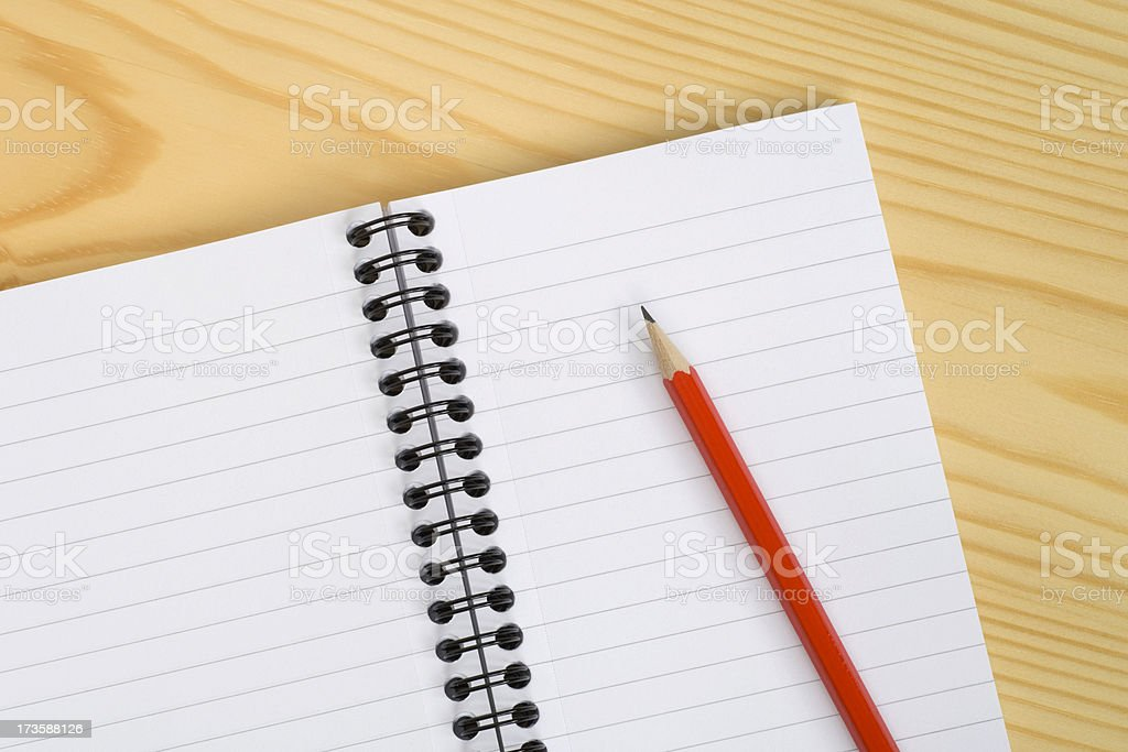 Notebook and pencil on desk royalty-free stock photo