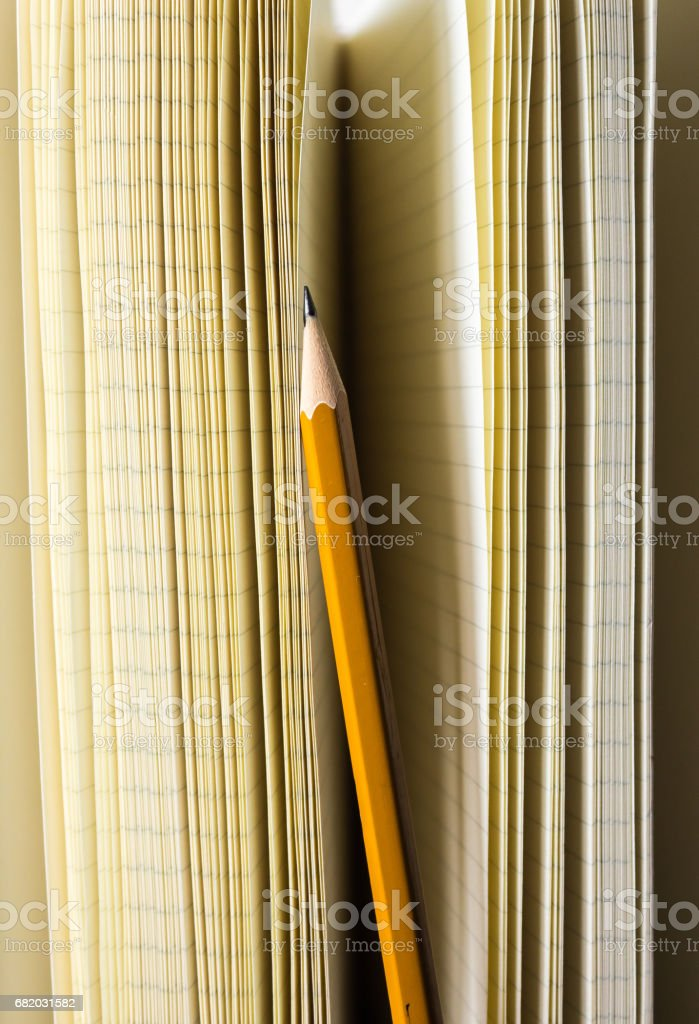Notebook and pencil upright stock photo