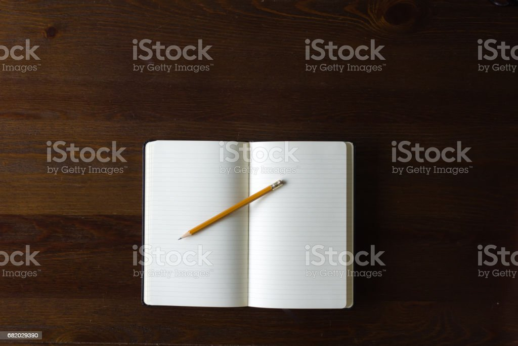 Notebook and pencil with copy space stock photo