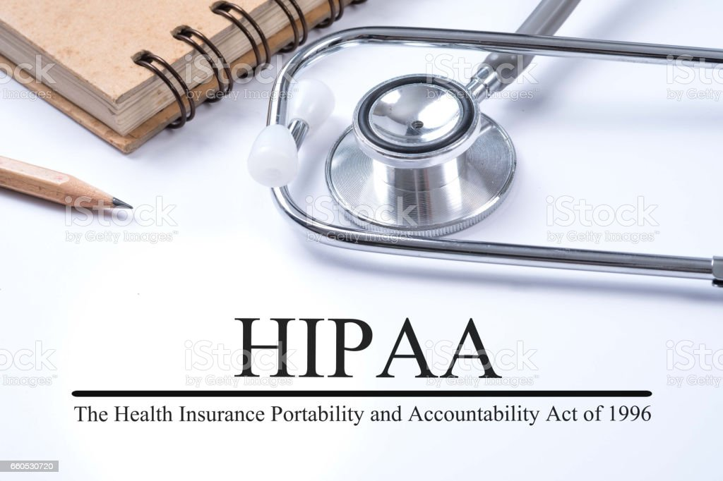 Notebook and pencil with HIPAA (The Health Insurance Portability and Accountability Act of 1996) on the table with stethoscope, medical concept stock photo