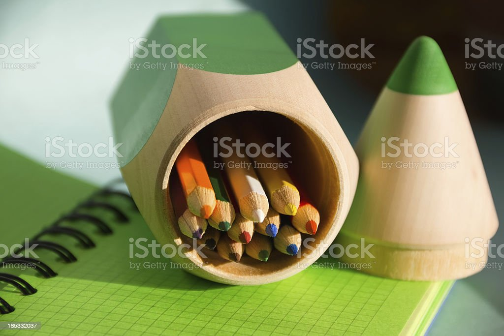 notebook and pencil-case with colored pencils royalty-free stock photo
