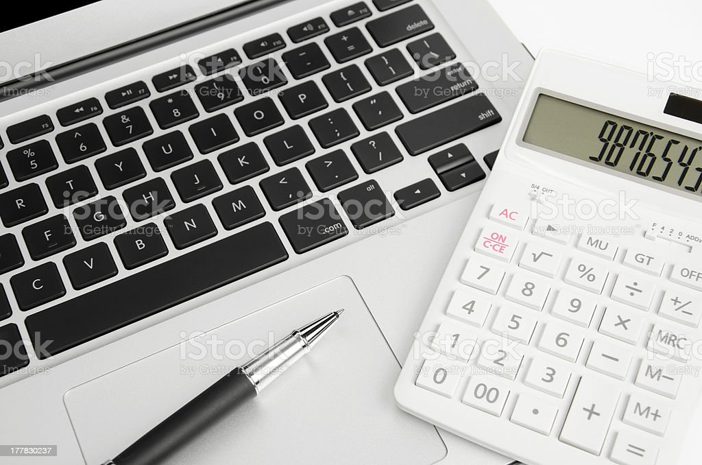 Notebook, calculator and pen stock photo