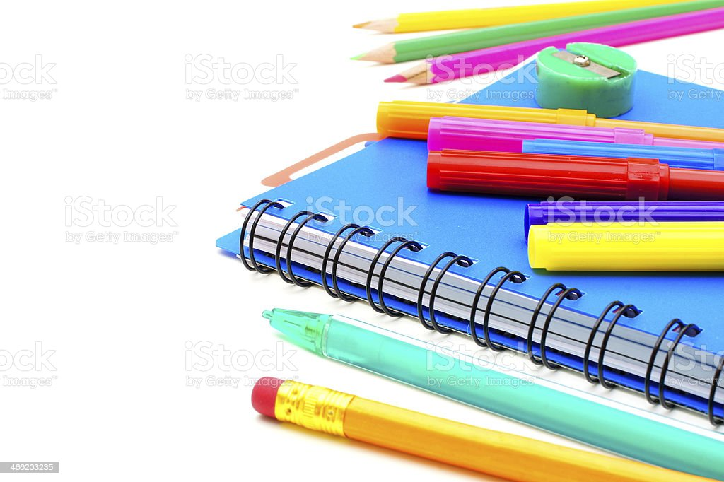 Notebook close up with colorful pens and pencils over white royalty-free stock photo