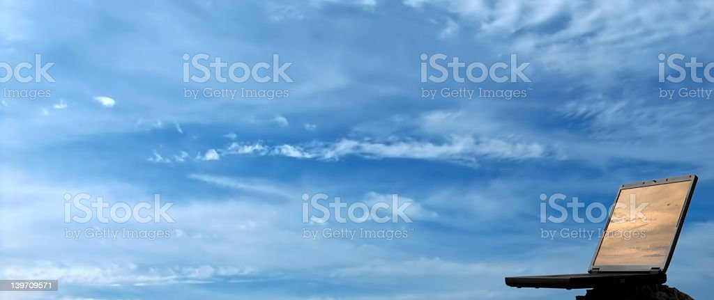 Notebook computer and sky royalty-free stock photo