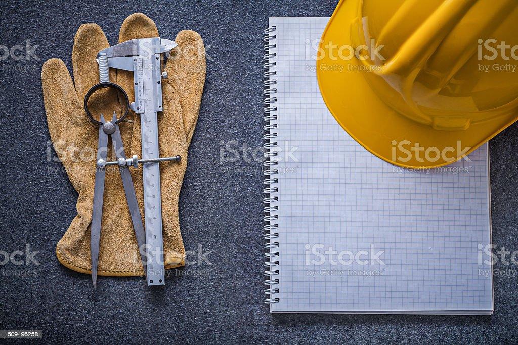 Notebook hard hat divider slide caliper safety gloves constructi stock photo