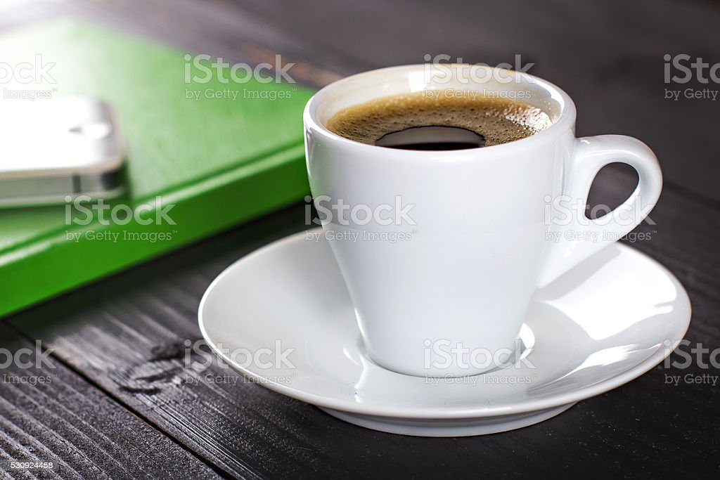 notebook, mobile phone and coffee cup stock photo