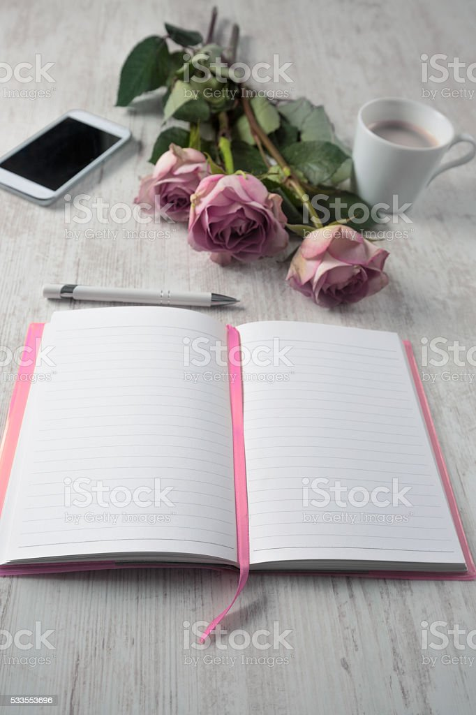 Notebook on a Table stock photo
