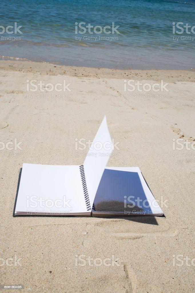 Notebook on beach background stock photo