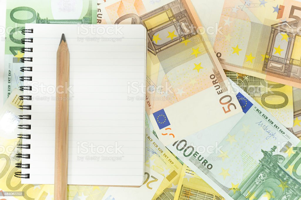 notebook on eurobanknotes stock photo