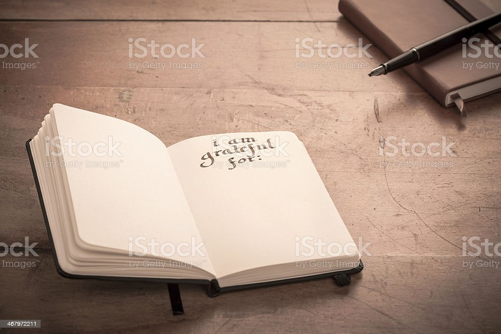 Notebook on Table - Gratitude Journal,  I am Grateful for: stock photo