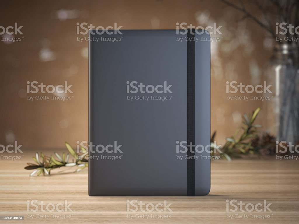 Notebook on the wooden table stock photo