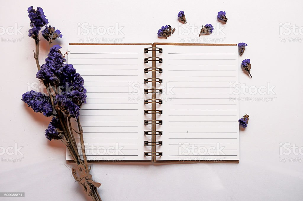 Notebook on white table stock photo