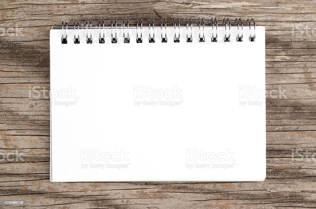 Notebook on wooden background stock photo
