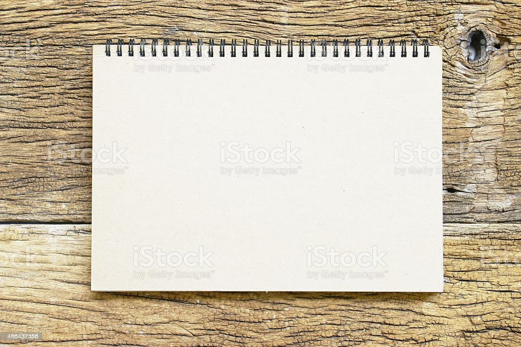 Notebook  on wooden table stock photo