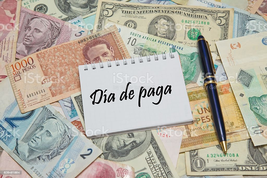 Notebook page with SPANISH text 'DIA DE PAGA' (PAYDAY) stock photo