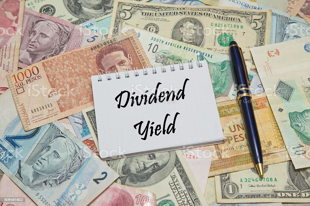 Notebook page with text DIVIDEND YIELD, stock photo