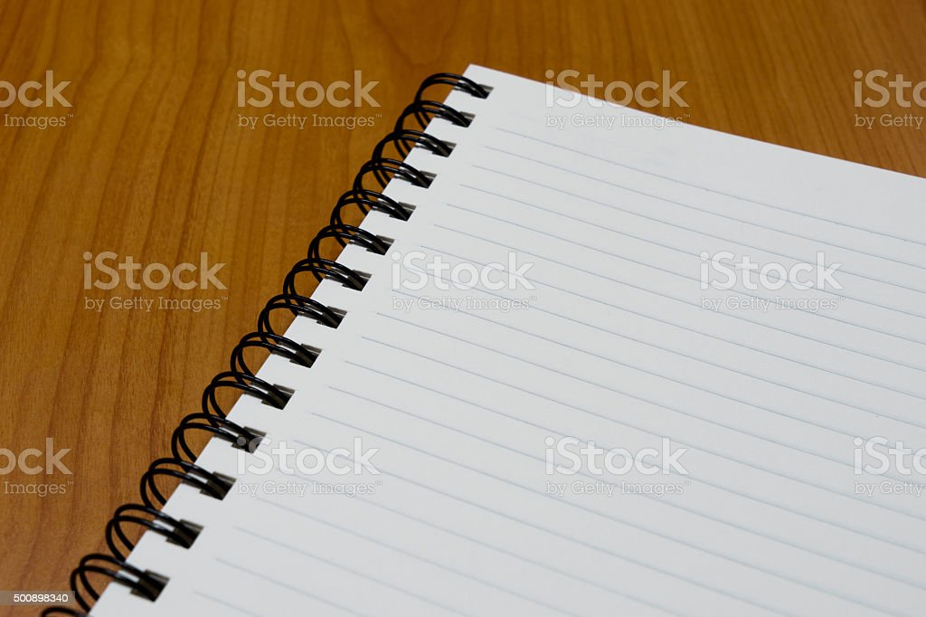 notebook paper on wood background stock photo
