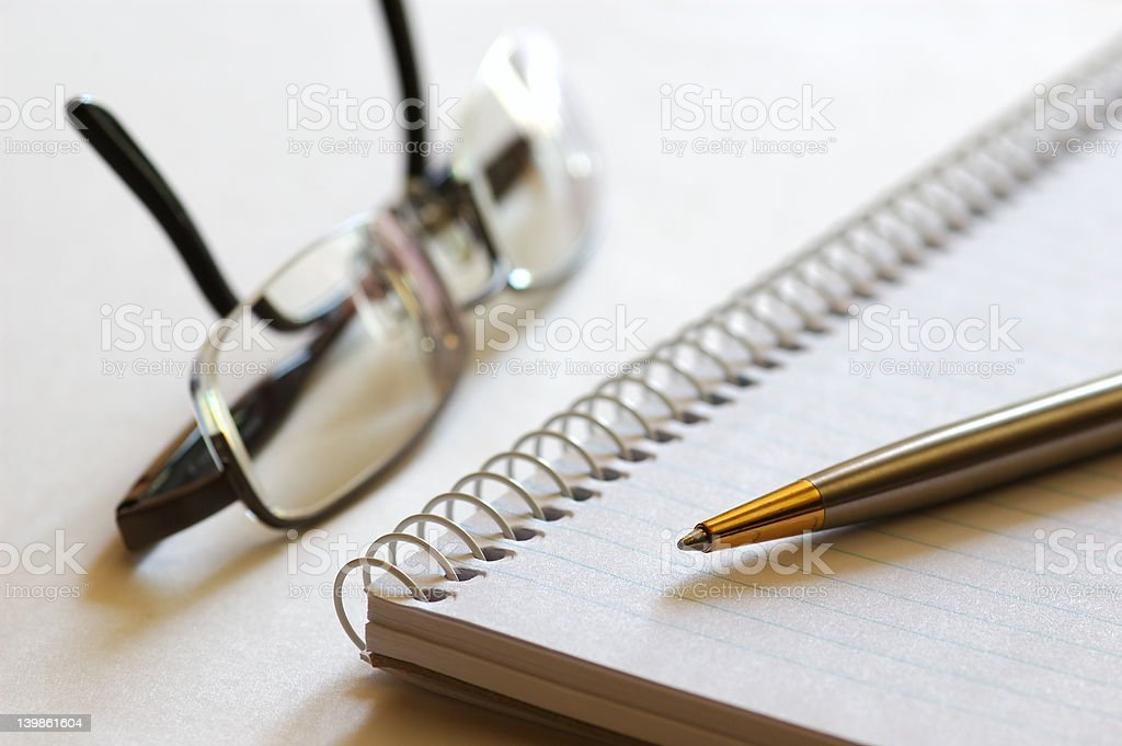 Notebook, Pen and Eyeglasses royalty-free stock photo