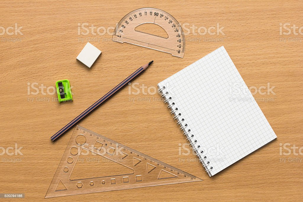 Notebook, pen, ruler on wooden desk. Directly above view. stock photo