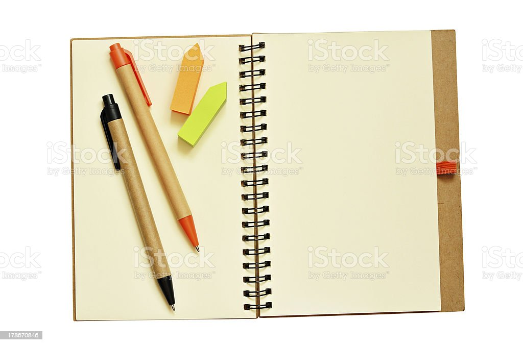 Notebook, pens, and stickers royalty-free stock photo