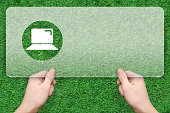notebook symbol message box with green grass background