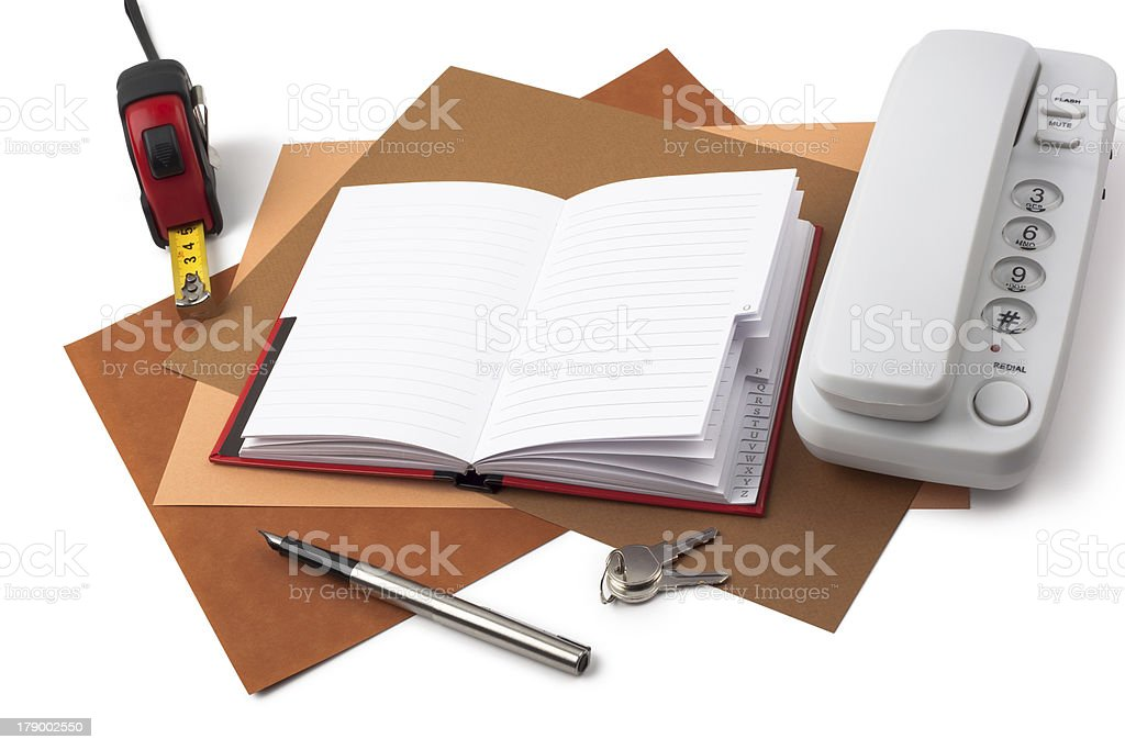 Notebook,  tape measure and white phone on textured  paper royalty-free stock photo