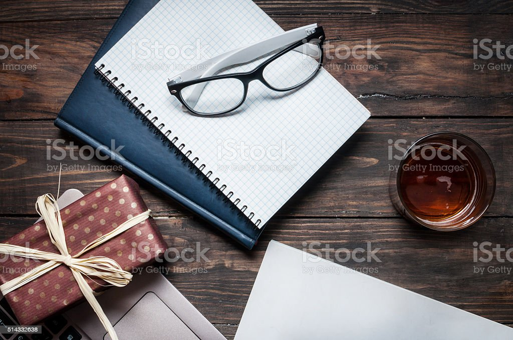 notebook with a glass, present, laptop, magazine stock photo