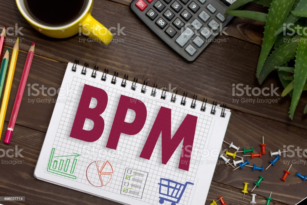 Notebook with a notes BPM on the office table with tools. Concept with elements of infographics. stock photo
