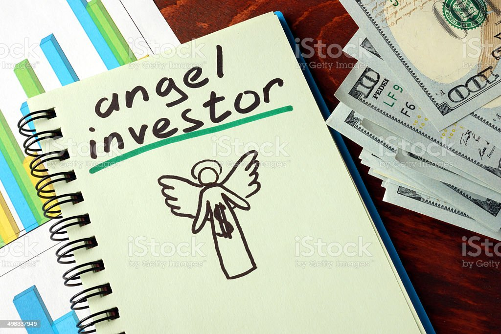 Notebook with angel investor  sign.  Business concept. stock photo