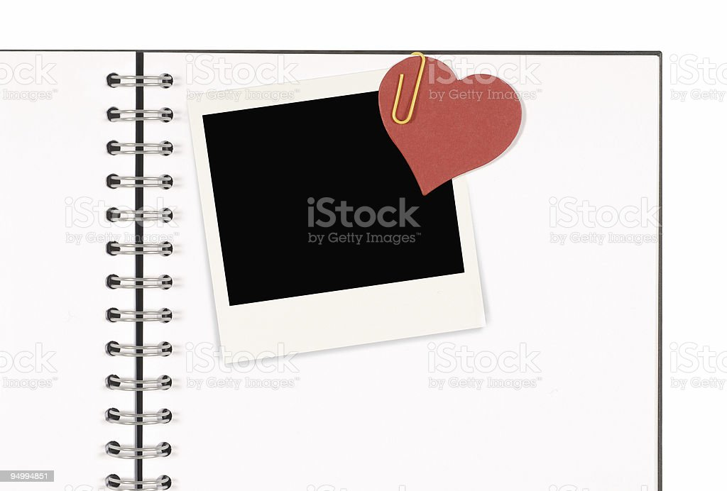 Notebook with blank instant photo print and red paper heart royalty-free stock photo