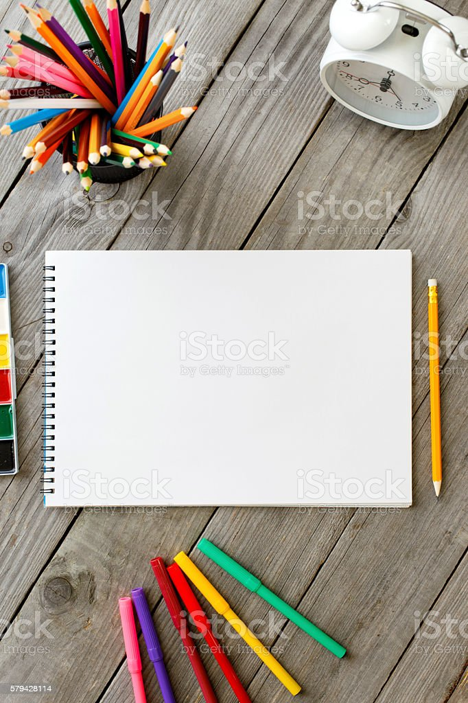 Notebook With Blank Pages And Colored Pencils stock photo