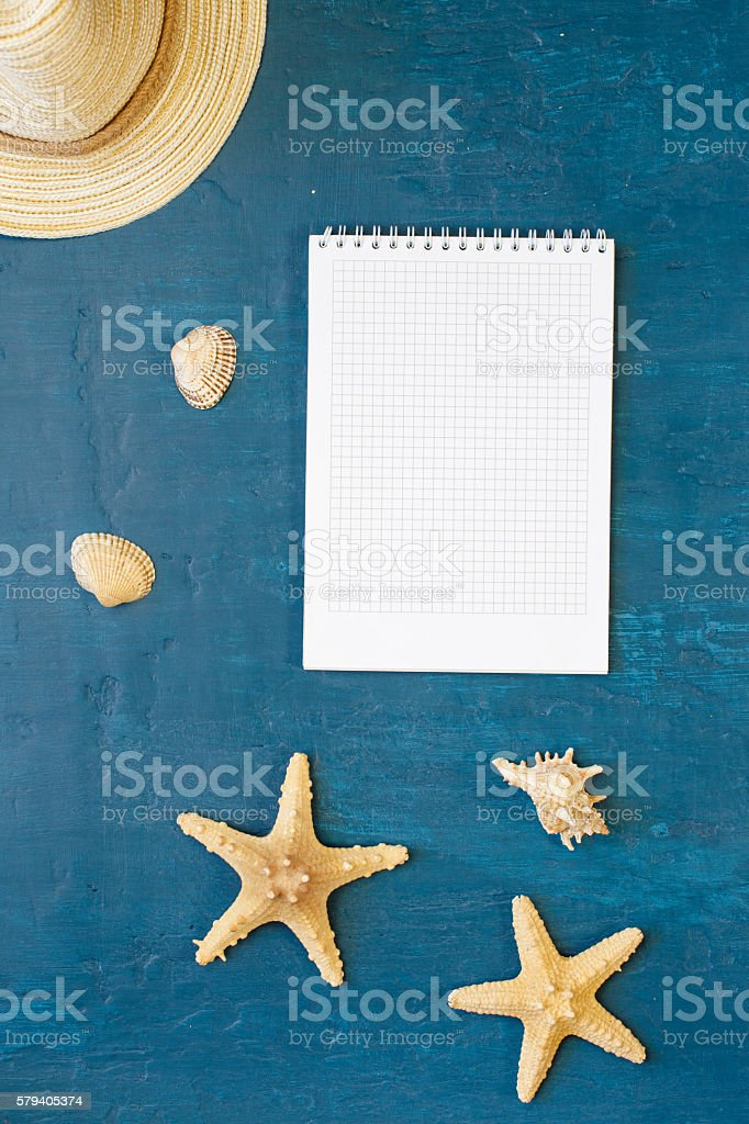 Notebook with blank pages with beach straw hat, seashells, starf stock photo