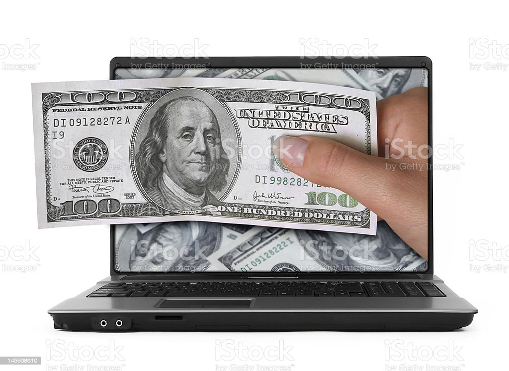 notebook with dollars stock photo
