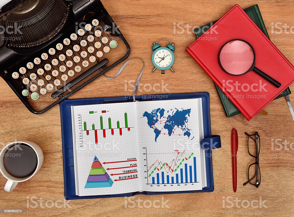notebook with drawing chart and international flights scheme stock photo